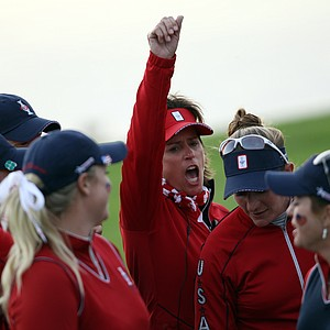 U.S. team captain Rosie Jones celebrates with her players after the final fourball game against Europe during Day 2 of The Solheim Cup at Killeen Castle.