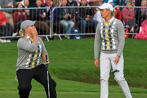 Europe's Caroline Hedwall, left, and Suzann Pettersen react after missing a putt on the 18th green during their fourballs match with Morgan Pressel and Cristie Kerr.