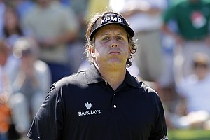 Phil Mickelson reacts after missing a birdie putt on the first hole during the third round of the Tour Championship golf tournament at East Lake Golf Club in Atlanta on Saturday, Sept. 24, 2011.