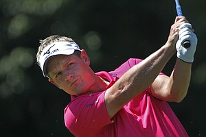 Luke Donald of England, watches his tee shot on the second hole during the third round of the Tour Championship golf tournament at East Lake Golf Club in Atlanta on Saturday, Sept. 24, 2011.