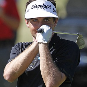 Keegan Bradley reacts after his eagle chip bounced out of the hole on the ninth green during the third round of the Tour Championship golf tournament at East Lake Golf Club in Atlanta on Saturday, Sept. 24, 2011.