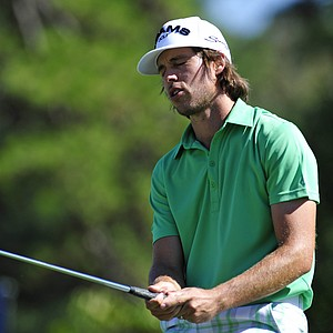 Aaron Baddeley, of Australia, reacts after missing a birdie putt on the 12th hole during the third round of the Tour Championship golf tournament at East Lake Golf Club, Saturday, Sept. 24, 2011, in Atlanta.
