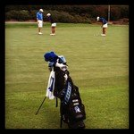 Duke players practice on the putting green after Saturday's round.