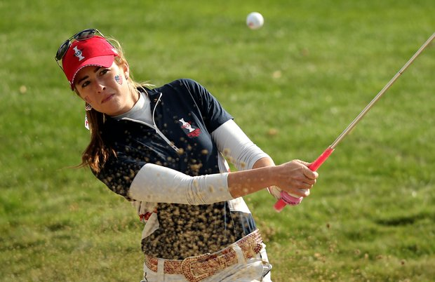 Paula Creamer hits from a bunker to the 18th green during the morning foursomes on Day 2 of the 2011 Solheim Cup at Killeen Castle Golf Club.