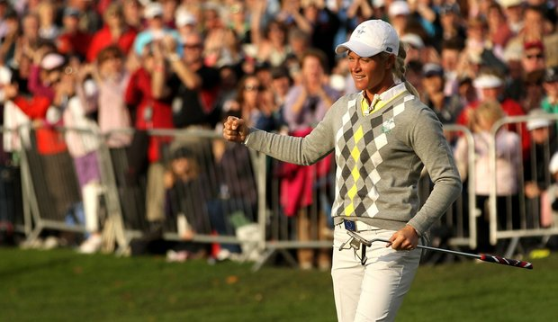 Suzann Pettersen celebrates holing a putt on the 16th green during the afternoon fourballs on Day 2 of the 2011 Solheim Cup at Killeen Castle.