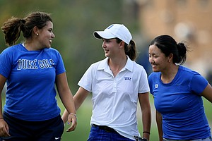 Duke's Lindy Duncan, center, is surrounded by teammates Alejandra Cangrejo, left, and Irene Jung, right, after she defeated Alabama's Jennifer Kirby in a playoff.