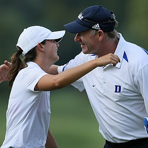 Duke head coach Dan Brooks hugs his player Lindy Duncan after she defeated Alabama's Jennifer Kirby in a playoff for the individual title during the final round at the Mason Rudolph Fall Preview.