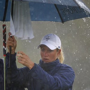 Europe's Suzann Pettersen shelters beneath her umbrella during her singles match against Michelle Wie of the U.S during the final day of The Solheim Cup at Killeen Castle in Dunsany near Dublin, on September 25, 2011.