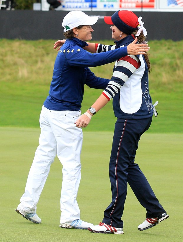 Catriona Matthew of Europe embraces Paula Creamer after Matthew won their singles match, 6 and 5, during Day 3 of the 2011 Solheim Cup at Killeen Castle Golf Club on September 25, 2011.