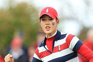 Michelle Wie of the U.S. celebrates on the 9th green during her singles match with Europe's Suzann Pettersen during the final day of the The Solheim Cup at Killeen Castle Dunsany near Dublin, Ireland on September 25, 2011.