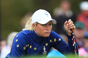 Europe's Suzann Pettersen of Norway lines up a putt on the 9th green during her singles match with Michelle Wie of the U.S. during the final day of the The Solheim Cup at Killeen Castle Dunsany near Dublin, Ireland on September 25, 2011.
