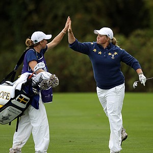 Europe's Caroline Hedwall, right, of Sweden reacts after she played her approach shot onto the 12th green during the singles match against Ryann O'Toole of the U.S. during the final day of The Solheim Cup at Killeen Castle in Dunsany near Dublin, Ireland on September 25, 2011.