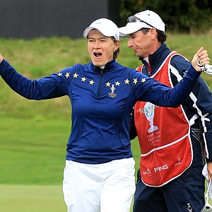 Catriona Matthew of Europe celebrates winning her match on the 13th green during the singles matches on Day 3 of the 2011 Solheim Cup at Killeen Castle Golf Club on September 25, 2011.