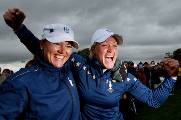Sophie Gustafson, left, and Suzann Pettersen of Europe celebrate their team's victory on the 18th green at Killeen Castle Golf Club on September 25, 2011.