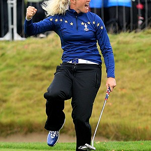 Suzann Pettersen of Europe celebrates holing a putt on the 15th green during her singles match against Michelle Wie on Day 3 of the 2011 Solheim Cup at Killeen Castle Golf Club on September 25, 2011. Pettersen would win the match 1 up.