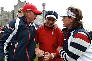 Ryann O'Toole of the U.S. is consoled by Stacy Lewis, left, and Captain Rosie Jones, right, following their team's 15-13 loss to Europe during the 2011 Solheim Cup at Killeen Castle Golf Club on September 25, 2011.