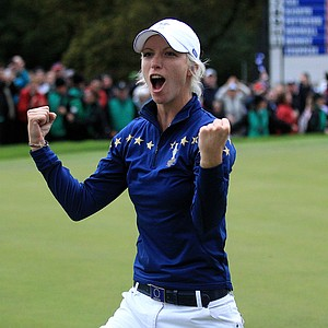 Melissa Reid of Europe celebrates her team's 15-13 victory on the 18th green after Day 3 of the 2011 Solheim Cup at Killeen Castle Golf Club on September 25, 2011