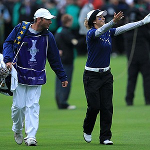 Azahara Munoz of Europe acknowledges the crowd on the 18th green after her team won the 2011 Solheim Cup at Killeen Castle Golf Club on September 25, 2011.