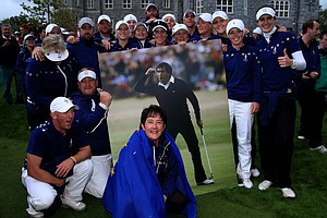 The Europe team and Captain Alison Nicholas celebrate their team's 15-13 victory on the 18th green with a giant picture of the late Seve Ballesteros at the 2011 Solheim Cup at Killeen Castle Golf Club on September 25, 2011.