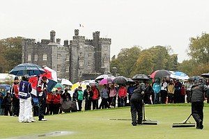Greenskeepers remove water from the 3rd green as rain falls during the singles matches on Day 3 of the 2011 Solheim Cup at Killeen Castle Golf Club on September 25, 2011.