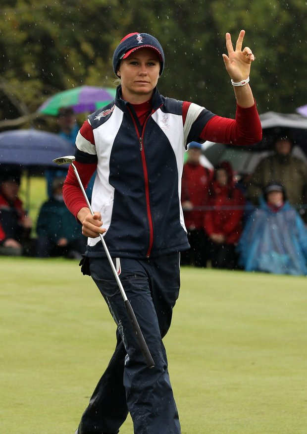 Ryann O'Toole of the U.S. acknowledges the crowd during her singles match against Caroline Hedwall on Day 3 of the 2011 Solheim Cup at Killeen Castle Golf Club on September 25, 2011.