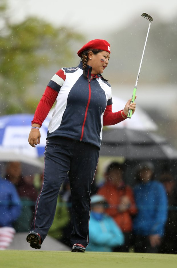 Christina Kim of the U.S. reacts to a putt on the 3rd green during the singles matches on Day 3 of the 2011 Solheim Cup at Killeen Castle Golf Club on September 25, 2011.