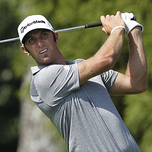 Dustin Johnson hits his tee shot on the second hole during the final round of the Tour Championship golf tournament at East Lake Golf Club in Atlanta on Sunday, Sept. 25, 2011.