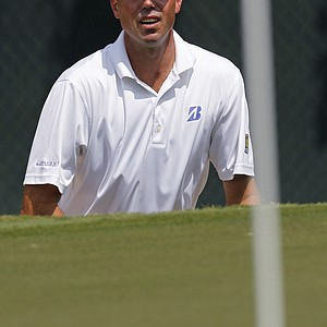 Matt Kuchar watches his sand shot land near the hole on the second green during the final round of the Tour Championship golf tournament at East Lake Golf Club in Atlanta on Sunday, Sept. 25, 2011.