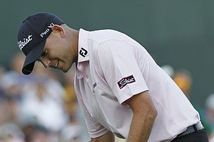 Bill Haas celebrates winning the FedEx Cup and the Tour Championship golf tournament on the third playoff hole against Hunter Mahan at East Lake Golf Club in Atlanta on Sunday, Sept. 25, 2011.