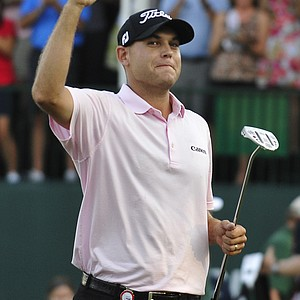Bill Haas celebrates winning the FedEx Cup and the Tour Championship golf tournament on the third playoff hole over Hunter Mahan at East Lake Golf Club in Atlanta on Sunday, Sept. 25, 2011.