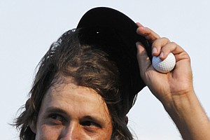 Aaron Baddeley, of Australia, tips his cap after completing play on the 18th green during the final round of the Tour Championship golf tournament at East Lake Golf Club in Atlanta on Sunday, Sept. 25, 2011.