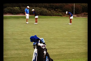 Duke players practice on the putting green well after play is over after the second round.