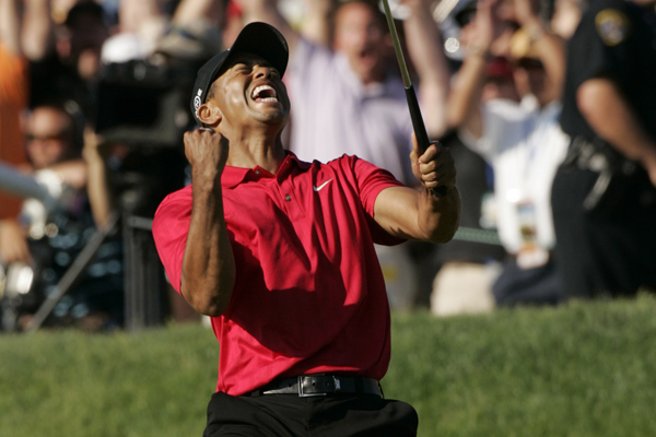 Tiger Woods celebrates after making a birdie to force a Monday playoff at the 2008 U.S. Open.