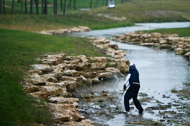 Steven Fox of Chattanooga does his best impression of FedEx champion Bill Haas in a stream that runs alongside Spirit Hollow's 18th hole during the second round of the Golfweek Conference Challenge.
