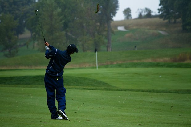 Cal freshman Michael Kim takes a large divot as he hits his approach on No. 18 at the Golfweek Conference Challenge.