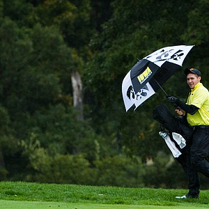 Iowa's Chris Brant shields himself from high winds and heavy downpours during Monday's second round of the Golfweek Conference Challenge.