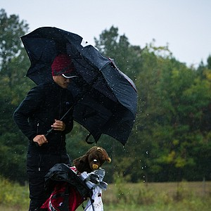 Arkansas' Sebastian Cappelen waits out one of the sudden downpours and heavy wind gusts that were commonplace throughout the second round of the Golfweek Conference Challenge.
