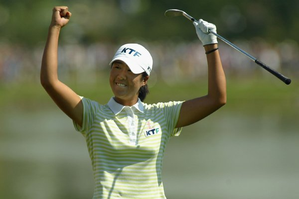 Birdie Kim celebrates after sinking a shot out of the eighteenth hole bunker during the final round of the 2005 U.S. Women's Open at Cherry Hills.