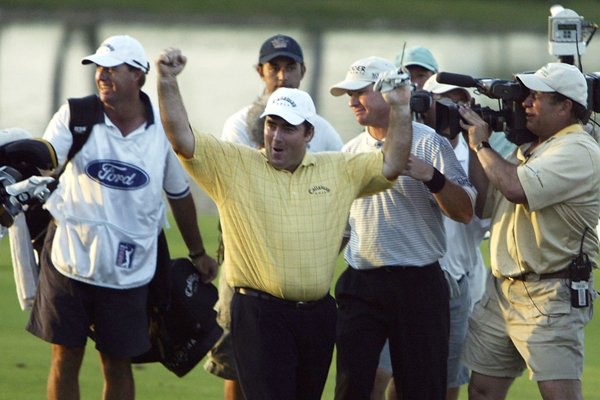 Craig Parry celebrates after holing a shot for eagle to defeat Scott Verplank on the first playoff hole at the 2004 Ford Championship at Doral.