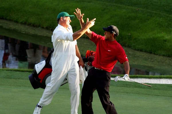 Tiger Woods and Steve Williams celebrate after Woods chipped in for birdie on the 16th hole during the final round of the 2005 Masters.