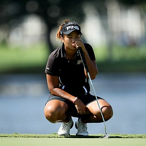 Junthima Gulyanamitta formerly of Purdue waits to putt during Stage II of LPGA Qualifying Tournament. Gulyanamitta and her former teammate Maude-Aimee Leblanc both advanced to the final stage.
