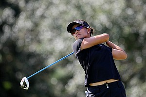 Stephanie Kono, a senior at UCLA, hits her tee shot at No. 18. Kono advanced to the final stage in Daytona Beach.