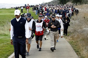 Tiger Woods leads the gallery down the second fairway during the first round of the Frys.Com Open.