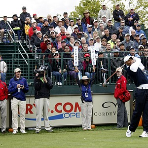 Tiger Woods tees off on the first hole at the first round of the Frys.Com Open.