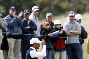 Tiger Woods acknowledges the crowd on the first green at the first round of the Frys.Com Open.