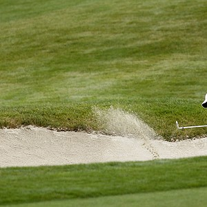 Tiger Woods hits his first bunker shot on the second hole during the first round of the Frys.Com Open.