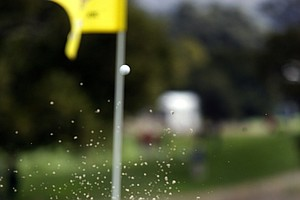 Tiger Woods hits his third bunker shot on the second hole during the first round of the Frys.Com Open.