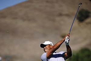 Tiger Woods makes a shot out of the rough on the 17th hole during the second round of the Frys.com Open.