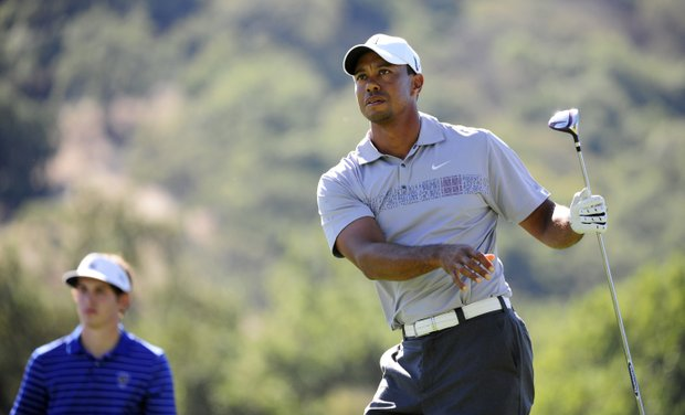 Tiger Woods makes a tee shot on the ninth hole as Patrick Cantlay during the second round of the Frys.com Open .