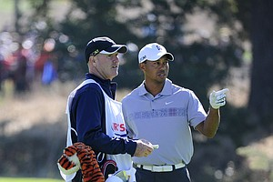 Tiger Woods with his caddie Joe LaCava during the second round of the Frys.com Open.
